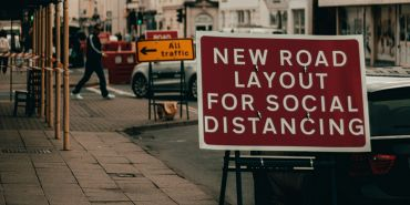 Social distancing road sign