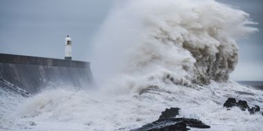 Huge wave battering English coastal defence